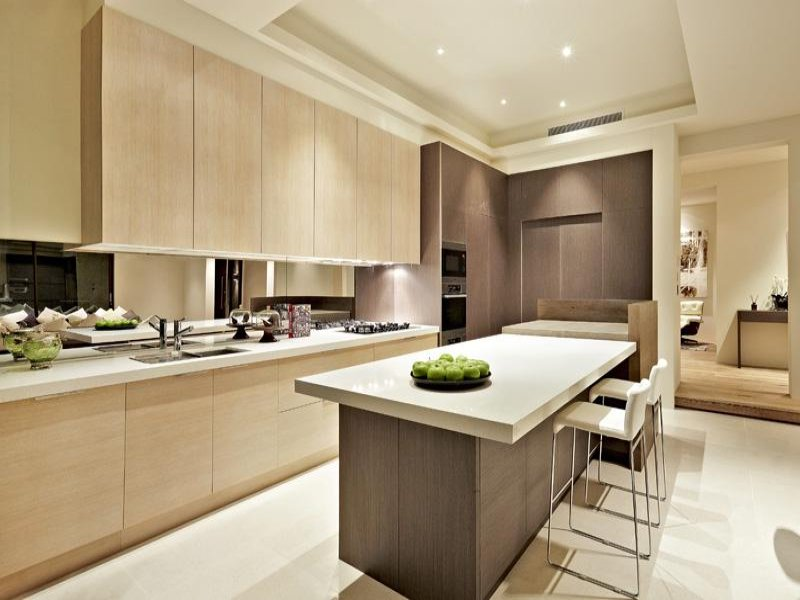 Modern island kitchen design using wood panelling Kitchen