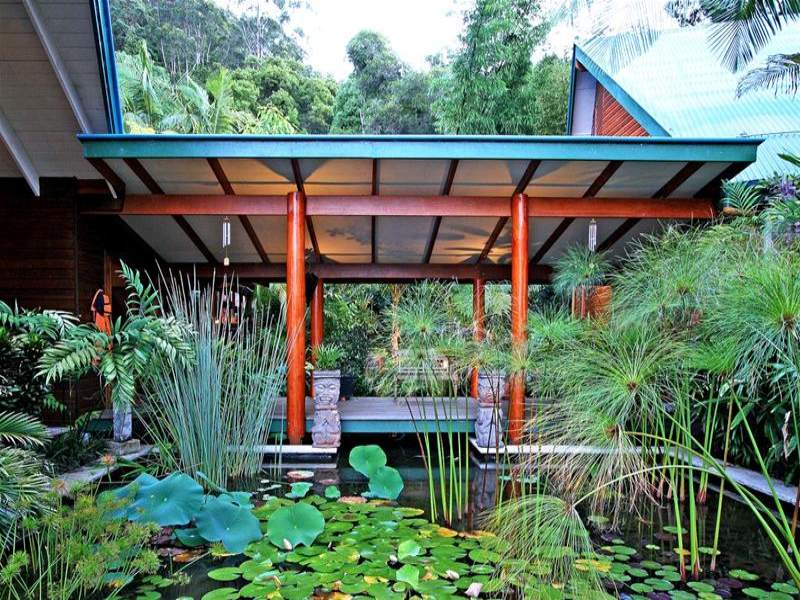Outdoor living design with fish pond from a real for Koi fish australia