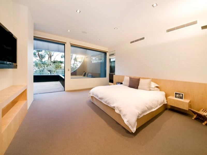 modern bedroom design idea with carpet balcony using neutral colours bedroom photo 1580132