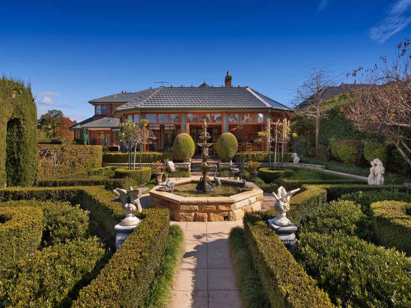 low maintenance garden design using grass with retaining wall  u0026 rockery