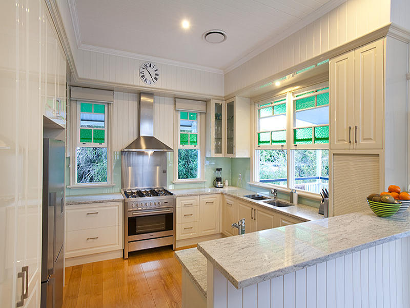 French provincial open plan kitchen design using wood for French provincial kitchen designs