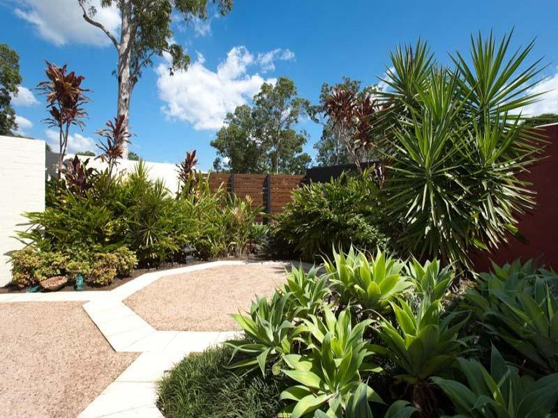Low maintenance garden design using tiles with verandah for Low maintenance garden design pictures