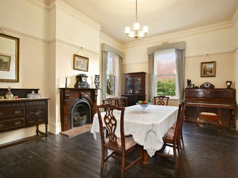 period dining room idea with floorboards fireplace