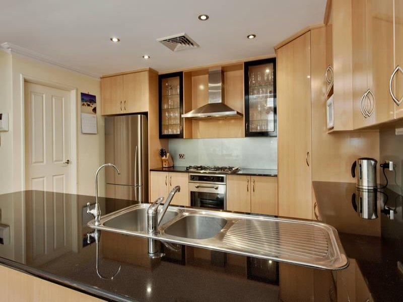 Classic galley kitchen design using floorboards kitchen for Kitchen ideas real estate