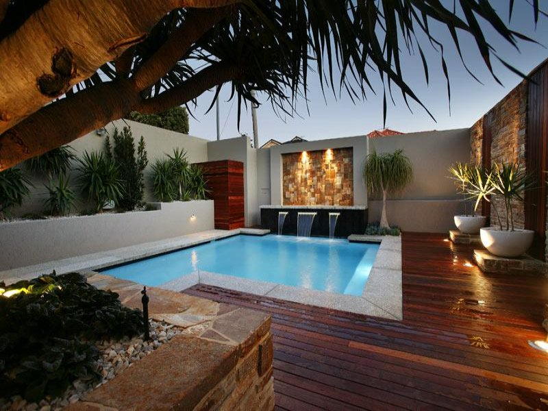 indoor pool design using timber with decking decorative lighting