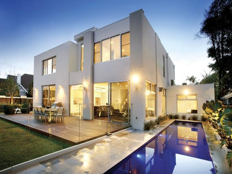 Concrete modern house exterior with bi fold windows for Modern window house
