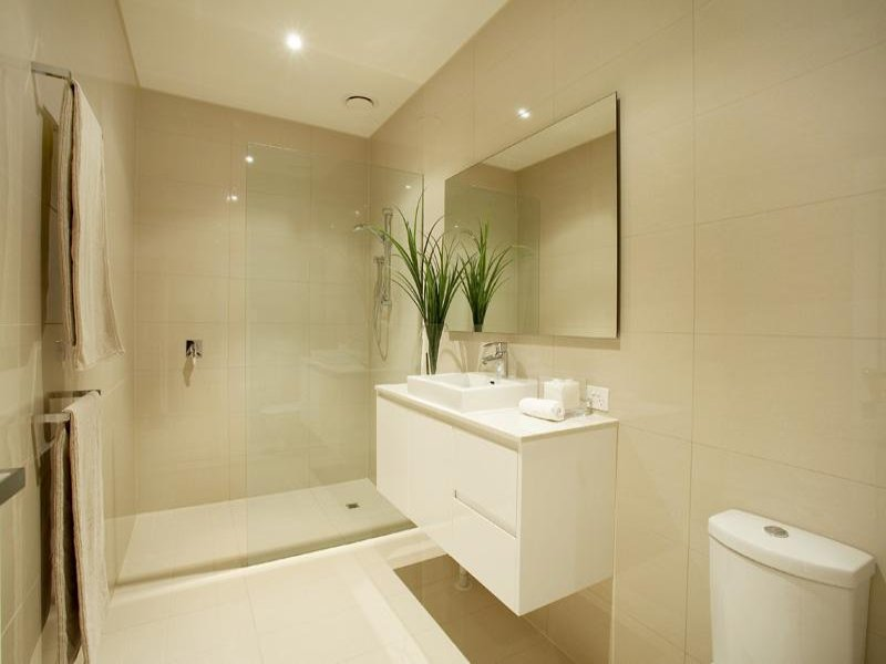 Country bathroom design with corner bath using tiles for Ensuite lighting ideas