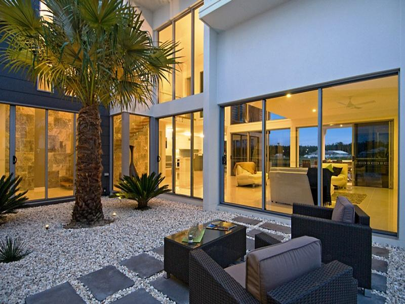 indoor-outdoor outdoor living design with verandah  u0026 decorative lighting using stone