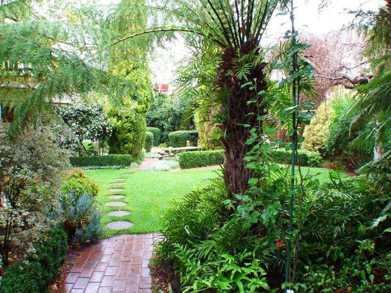garden design using brick with gazebo hedging Gardens photo 304720