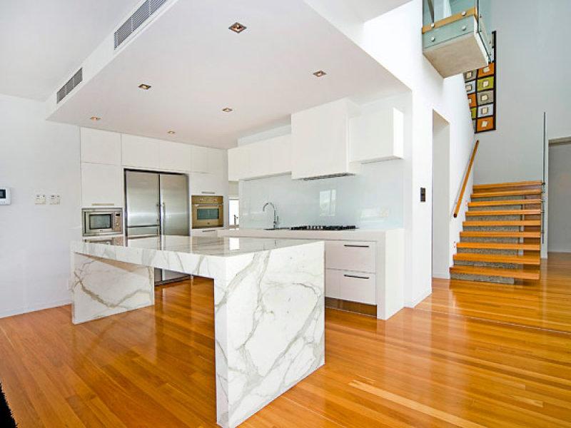 Modern island kitchen design using floorboards - Kitchen Photo 360582