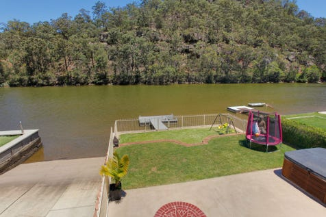 61 Walmsley Road, Lower Macdonald, 2775, Central Coast - House / IMMACULATE WATERFRONT HOME, JETTY AND PONTOON / Carport: 1 / Garage: 3 / Air Conditioning / Dishwasher / $955,000