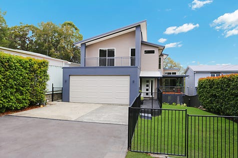 20 Anita Avenue, Lake Munmorah, 2259, Central Coast - House / SPECTACULAR WATERFRONT / Balcony / Garage: 2 / Open Spaces: 4 / Secure Parking / Air Conditioning / Floorboards / Toilets: 4 / $895,000