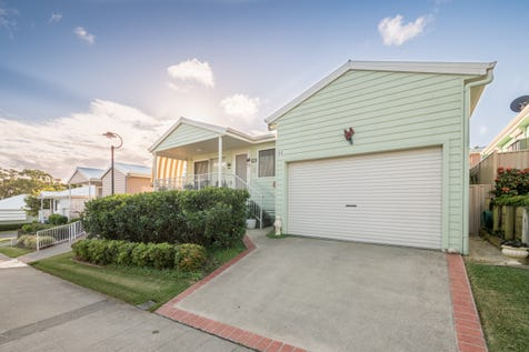 2 Saliena Avenue, Lake Munmorah, 2259, Central Coast - House / EXCEPTIONAL BUYING -IMMACULATE HOME IN OVER 50's RESORT / Deck / Fully Fenced / Swimming Pool - Inground / Tennis Court / Garage: 1 / Remote Garage / Secure Parking / Air Conditioning / Broadband Internet Available / Built-in Wardrobes / Dishwasher / Gym / $387,000