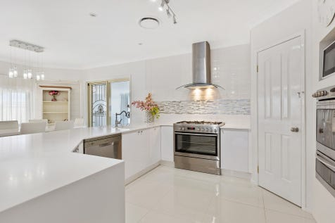 50 Piper Drive, Hamlyn Terrace, 2259, Central Coast - House / Enviable Large Family Home / Outdoor Entertaining Area / Garage: 2 / Built-in Wardrobes / Ducted Cooling / Ducted Heating / Rumpus Room / Study / Ensuite: 1 / $825,000