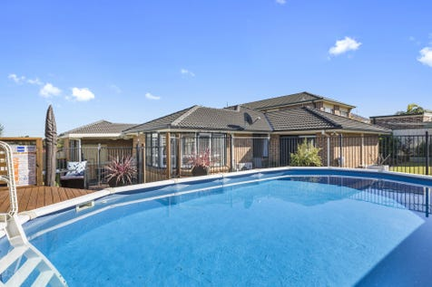 13 Crowe Street, Lake Haven, 2263, Central Coast - House / Stunning 5 Bedroom Family Home With Pool / Fully Fenced / Outdoor Entertaining Area / Swimming Pool - Above Ground / Swimming Pool - Inground / Garage: 2 / Remote Garage / Air Conditioning / Built-in Wardrobes / Floorboards / Rumpus Room / Ensuite: 1 / $670,000