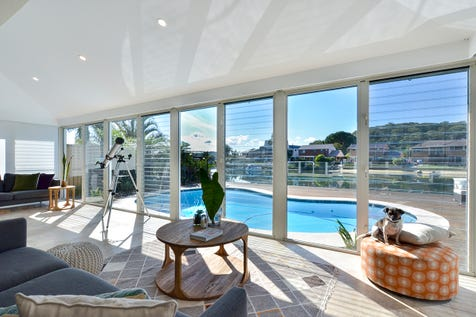 35 Helmsman Blvd, St Huberts Island, 2257, Central Coast - House / Resort Style Single Level Waterfront Living / Balcony / Swimming Pool - Inground / Garage: 2 / Open Spaces: 2 / Secure Parking / Air Conditioning / $1,500,000