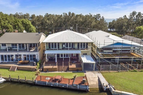 298 Geoffrey Road, Chittaway Point, 2261, Central Coast - House / CENTRAL COAST WATERFRONT - DEEPWATER WITH SLIPWAY, SEAWALL AND JETTY / Deck / Outdoor Entertaining Area / Garage: 6 / Remote Garage / Secure Parking / Ducted Cooling / Ducted Heating / Floorboards / $1,499,000