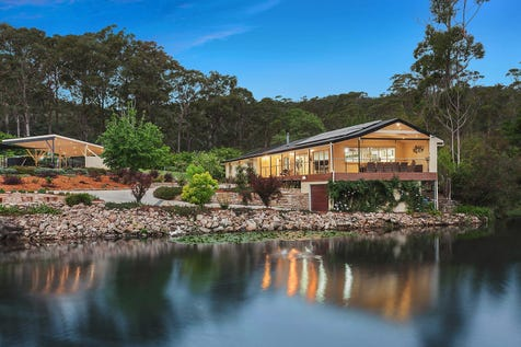 21 Pomona Road, Empire Bay, 2257, Central Coast - House / Magnificent home on 7.5 acres of manicured gardens and bushland / Deck / Swimming Pool - Inground / Garage: 3 / Air Conditioning / Built-in Wardrobes / Dishwasher / P.O.A
