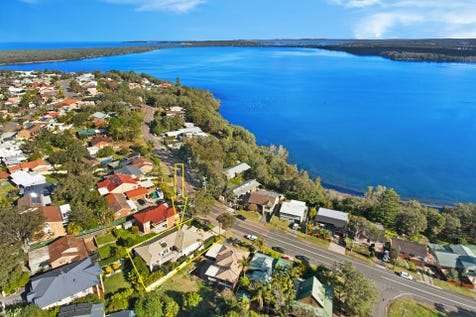 31 Anita Avenue, Lake Munmorah, 2259, Central Coast - House / Immaculate Family Home with Water Views / Deck / Fully Fenced / Outdoor Entertaining Area / Shed / Garage: 2 / Remote Garage / Secure Parking / Air Conditioning / Built-in Wardrobes / Dishwasher / Floorboards / Split-system Air Conditioning / Workshop / P.O.A