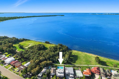 311 Lakedge Avenue, Berkeley Vale, 2261, Central Coast - House / Architecturally designed waterfront family home / Garage: 4 / $900,000