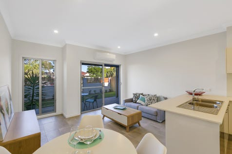 2/3 Britannia St, Umina Beach, 2257, Central Coast - Townhouse / EFFERVESCENT! / Courtyard / Deck / Fully Fenced / Outdoor Entertaining Area / Garage: 2 / Remote Garage / Secure Parking / Air Conditioning / Alarm System / Broadband Internet Available / Built-in Wardrobes / Dishwasher / Ensuite: 1 / $720,000