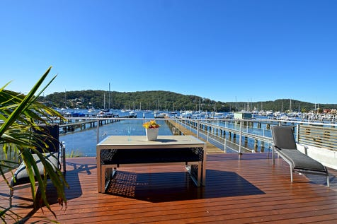 2/54 Booker Bay Road, Booker Bay, 2257, Central Coast - House / WATCH THE SUN BOUNCE OFF THE WATER! / Carport: 2 / Air Conditioning / $1,750,000