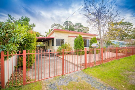 19 Squirell Street, Woy Woy, 2256, Central Coast - House / Duel Income! Investors take note! / Fully Fenced / Carport: 2 / Air Conditioning / Living Areas: 2 / Toilets: 2 / P.O.A