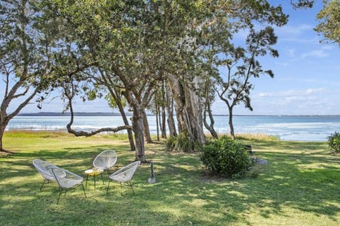 14 Lett Street, Gorokan, 2263, Central Coast - House / STUNNING WATERFRONT BEACHCOMBER / Balcony / Fully Fenced / Outdoor Entertaining Area / Shed / Carport: 2 / Garage: 1 / Secure Parking / Air Conditioning / Alarm System / Broadband Internet Available / Built-in Wardrobes / Dishwasher / Floorboards / Study / $795,000