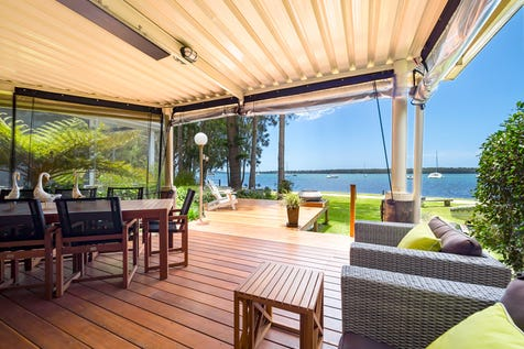 26a Gymea Crescent, Mannering Park, 2259, Central Coast - House / LUXURY LAKESIDE LIVING - WATERFRONT RESERVE / Balcony / Garage: 1 / Open Spaces: 1 / Secure Parking / Air Conditioning / Toilets: 2 / $830,000
