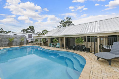 33 Derwent Drive, Lake Haven, 2263, Central Coast - House / Poolside Living Made Easy / Fully Fenced / Outdoor Entertaining Area / Swimming Pool - Inground / Garage: 2 / Air Conditioning / Built-in Wardrobes / Dishwasher / Rumpus Room / Study / Ensuite: 1 / Toilets: 2 / $720,000