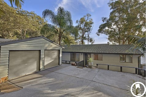 18 Yugari Crescent, Daleys Point, 2257, Central Coast - House / PEACEFUL & PRIVATE LEAFY SANCTUARY COMPLETE WITH WATER VIEWS / Balcony / Deck / Outdoor Entertaining Area / Shed / Garage: 2 / Remote Garage / Secure Parking / Air Conditioning / Built-in Wardrobes / Dishwasher / Floorboards / Ensuite: 1 / $700,000