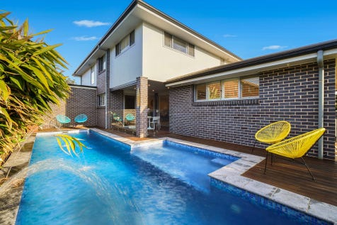 14 Del Rio Drive, Copacabana, 2251, Central Coast - House / Stunning family home only 160m level walk from the beach / Balcony / Swimming Pool - Inground / Garage: 2 / Secure Parking / Air Conditioning / Built-in Wardrobes / $1,400,000