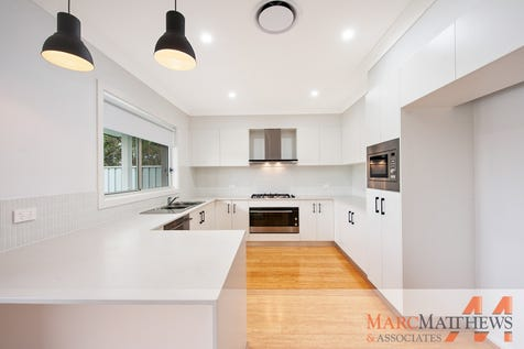 1/1 Vidler Ave, Woy Woy, 2256, Central Coast - Villa / Ultra Modern Villa - No Expense Spared / Courtyard / Fully Fenced / Outdoor Entertaining Area / Garage: 2 / Remote Garage / Alarm System / Built-in Wardrobes / Dishwasher / Ducted Cooling / Ducted Heating / Floorboards / Reverse-cycle Air Conditioning / $749,000
