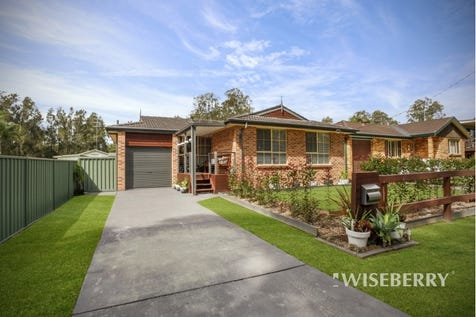 61 Warner  Avenue, Tuggerawong, 2259, Central Coast - House / FANTASTIC FAMILY HOME / Garage: 3 / Air Conditioning / $570,000