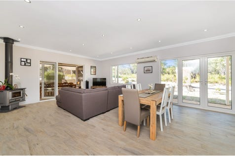 69 Ghost Gum Ridge, Chittering, 6084, Central Coast - House / 4 bedroom house / Outdoor Entertaining Area / Shed / Carport: 2 / Secure Parking / Air Conditioning / Broadband Internet Available / Built-in Wardrobes / Open Fireplace / Pay TV Access / Workshop / Ensuite: 1 / Living Areas: 2 / $579