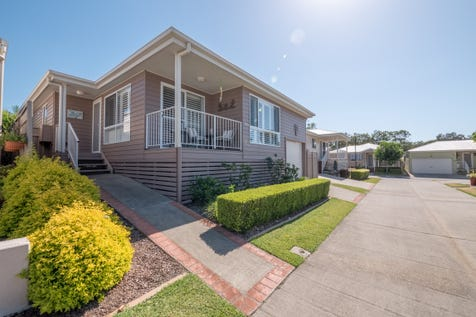 2 Saliena Avenue, Lake Munmorah, 2259, Central Coast - House / PRETTY AS A PICTURE-  RESORT LIVING AT ITS BEST! / Balcony / Courtyard / Deck / Fully Fenced / Outdoor Entertaining Area / Swimming Pool - Above Ground / Swimming Pool - Inground / Tennis Court / Garage: 1 / Remote Garage / Secure Parking / Dishwasher / $365,000