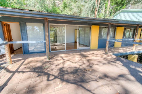 86 Ryans Road, Umina Beach, 2257, Central Coast - House / Embracing an elevated position with bushland setting / Balcony / Courtyard / Carport: 1 / Built-in Wardrobes / Dishwasher / Living Areas: 2 / $610,000