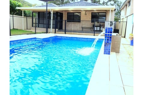 9 Coolabah Street, Ettalong Beach, 2257, Central Coast - House / Large resort style family home in quite prime location / Fully Fenced / Outdoor Entertaining Area / Swimming Pool - Inground / Garage: 2 / Remote Garage / Secure Parking / Air Conditioning / Alarm System / Broadband Internet Available / Built-in Wardrobes / $1,010,000