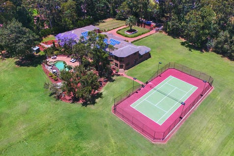 35 Pomona Road, Empire Bay, 2257, Central Coast - House / Peaceful paradise on a grand scale / Deck / Tennis Court / Garage: 4 / Air Conditioning / Built-in Wardrobes / Dishwasher / Gym / P.O.A