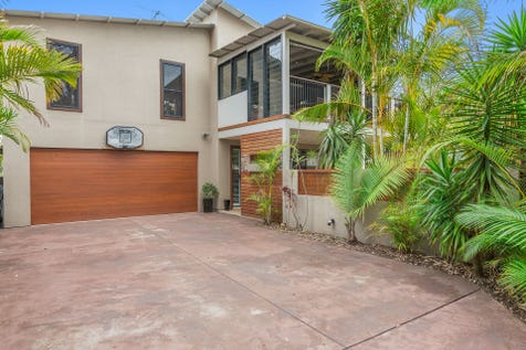 132 Lakedge Ave, Berkeley Vale, 2261, Central Coast - House / Tropical Haven / Deck / Outdoor Entertaining Area / Shed / Garage: 2 / Air Conditioning / Broadband Internet Available / Built-in Wardrobes / Dishwasher / $750,000