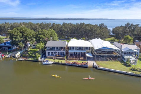 298 Geoffrey Road, Chittaway Point, 2261, Central Coast - House / CENTRAL COAST WATERFRONT - DEEPWATER WITH SLIPWAY, SEAWALL AND JETTY / Deck / Outdoor Entertaining Area / Garage: 6 / Remote Garage / Secure Parking / Ducted Cooling / Ducted Heating / Floorboards / $1,450,000