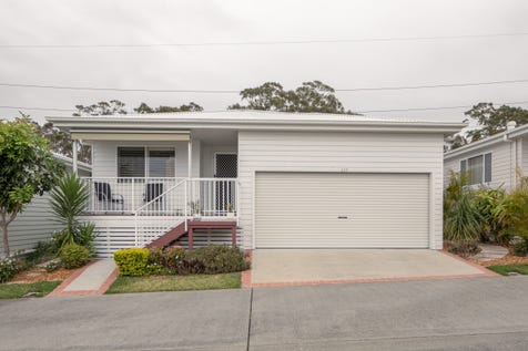 2 Saliena Avenue, Lake Munmorah, 2259, Central Coast - House / OFTEN SOUGHT - RARELY FOUND! / Deck / Fully Fenced / Outdoor Entertaining Area / Shed / Swimming Pool - Inground / Tennis Court / Garage: 2 / Open Spaces: 1 / Remote Garage / Secure Parking / Air Conditioning / Broadband Internet Available / Dishwasher / $427,000