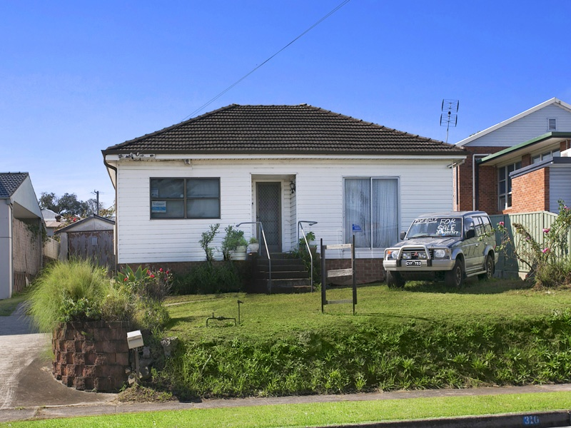310 Northcliffe Drive, Lake Heights, NSW 2502