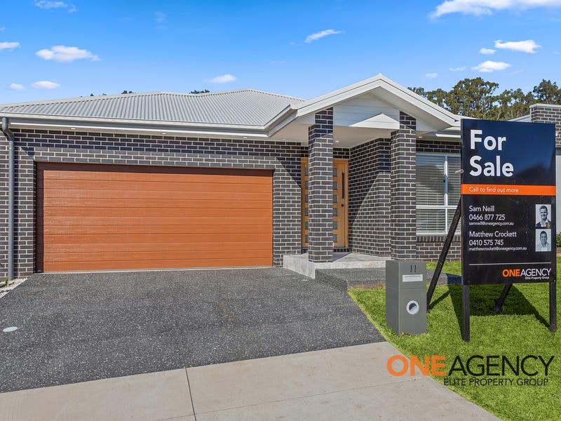 11 Coral Tree Crescent, Calderwood, NSW 2527