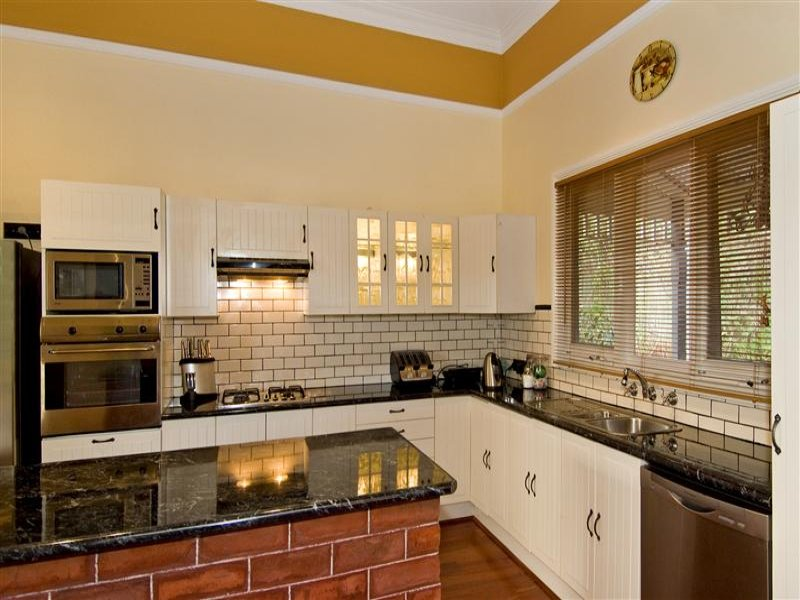a a kitchen cabinets country l shaped kitchen design using exposed brick 10404